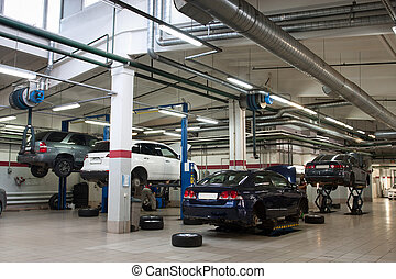 Cars in a repair garage