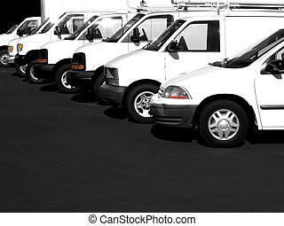 White cars in a row in a parking lot or car lot