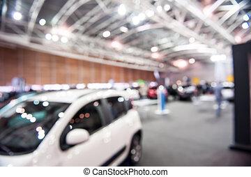 Cars in an exhibition. Defocus