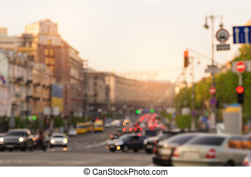cars in big city on road with blurred focus