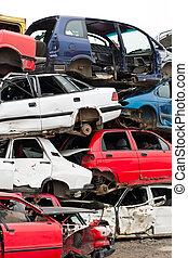 Cars in junkyard - Piled up destroyed cars in the junkyard.
