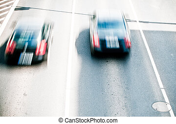 Cars in motion blur on a street of Wroclaw - city with the...