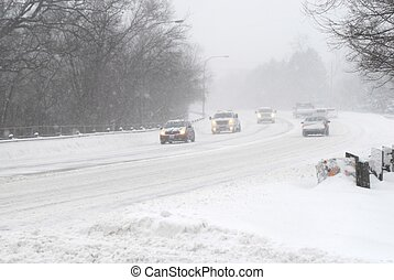 Cars driving on street in snow storm with headlights on. (08 February 2013, Mississauga, Ontario, Canada)