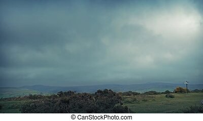 Cars In The Cloudy Highlands - Cars passing on windswept...