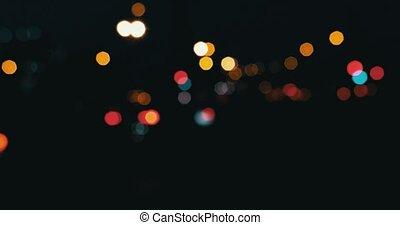 Cars in the night defocused. Blurred street lights