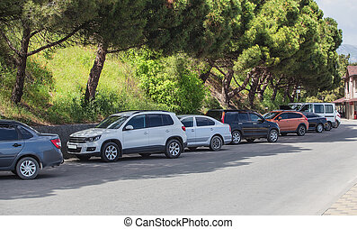 Cars in the parking lot along the street