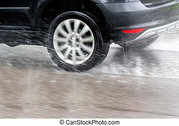 cars in the rain - car driving in the rain on a wet road. ...