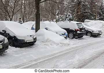 Cars in the snow parked in the winter