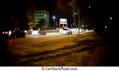 Cars in the street night footage shot with old c-mount lens, vintage looking