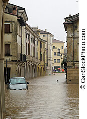 cars in the streets and roads submerged by the mud of the flood after the flooding of the River 2