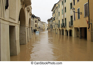 cars in the streets and roads submerged by the mud of the flood after the flooding of the River 3