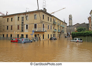cars in the streets and roads submerged by the mud of the flood after the flooding of the River