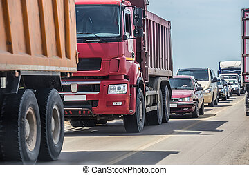 cars in traffic jam on the road