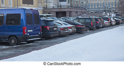 Cars in winter in a parking lot
