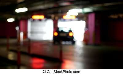 Cars leave from the underground parking, blurred