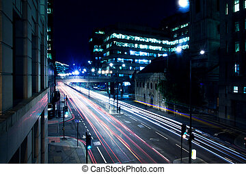 Cars lights on London street by night