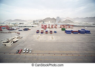 cars, many cargos, buildings and other constructions in port.