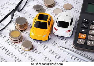 Cars, money, calculator and pen