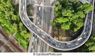 cars move slowly on upper loop of multi-level interchange -...