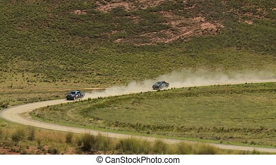 Cars Moving On A Remote Curving Road, Andes, Peru