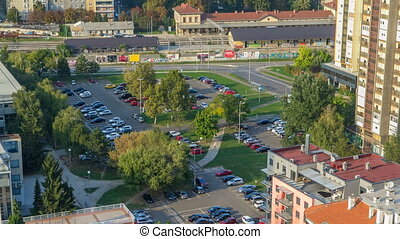 Cars moving on parking lot timelapse with green trees. CROATIA, ZAGREB