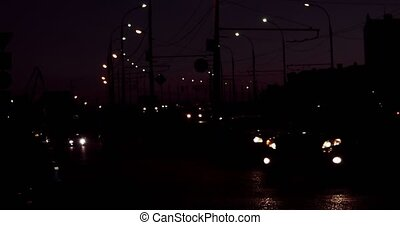 Cars moving slow in the dark.