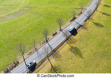 cars on an avenue from above in the sun