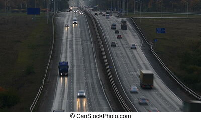 cars on highway road in dusk, timelapse