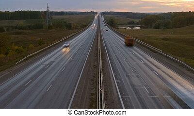 cars on highway road in dusk, zoom in timelapse