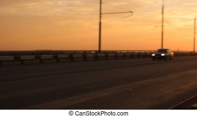 Cars on morning freeway moving in slow motion pan right shot...