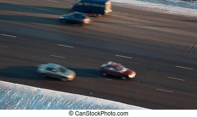 cars on road in the winter afternoon on highway