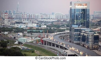 Cars on road near Northern Tower of Moscow International...
