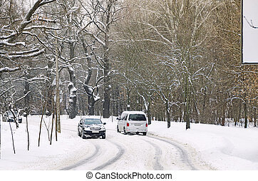 Cars on the curved slippery road in the countryside.