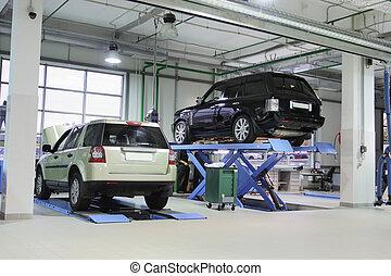 repair garage - Cars on the elevator in a repair garage
