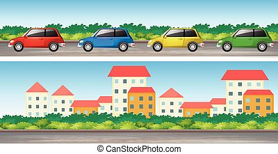 Cars on the road and many buildings