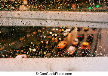 Cars on the road with traffic. Traffic cars in the cold, rainy day. Blurry lights of cars. Bad weather for driving. Shallow depth of field urban background