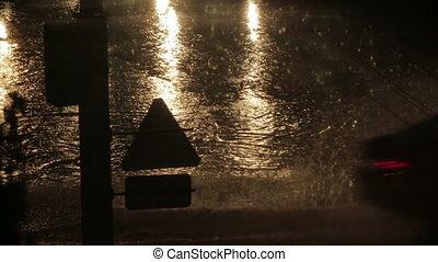 Cars on wet road in rain