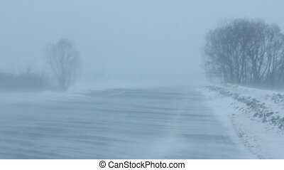 cars on winter road at blizzard