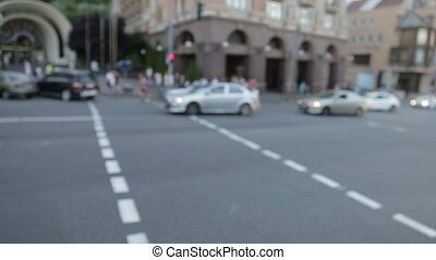 Cars out of focus on the roadway - In the blur of cars on...
