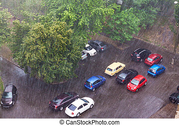 Cars parked in the rain