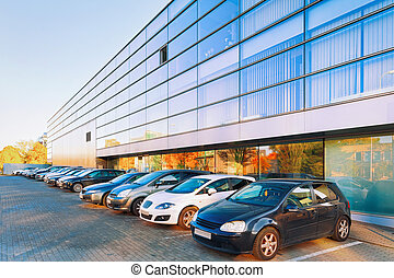 Cars parked on street at Office corporate building