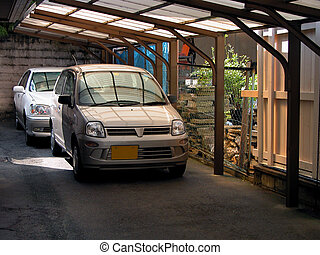 A characteristic Japanese cars parking, nearly the house.