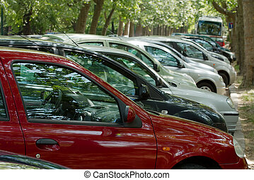 Cars parking in a row, focus on the red one