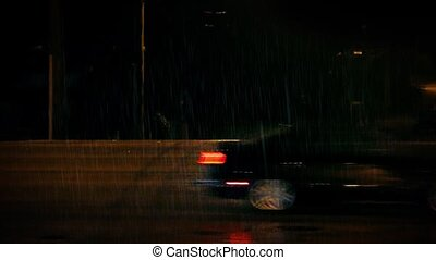 Cars Pass On Road At Night - Side view of cars passing in...