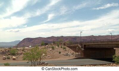 Cars pass over a deseet overpass