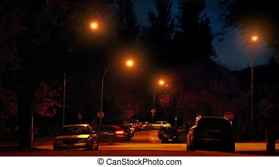 Cars Pass Through Residential Area At Night - Many cars pass...