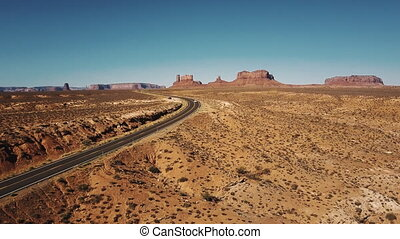 Cars passing by drone camera on desert highway road at sunny...