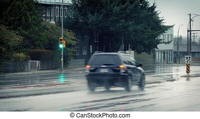 Cars Passing Crossing In The Rain - Cars driving on wet road...