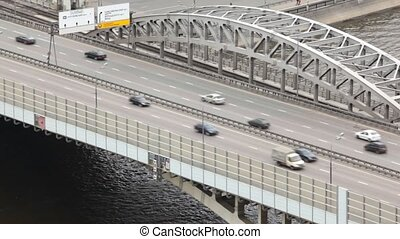 Cars quickly go on Andreevsky bridge on multilane highway