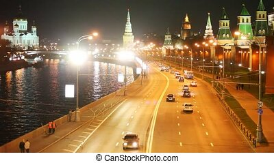 Cars, road, river, Kremlin walls and towers in Moscow city
